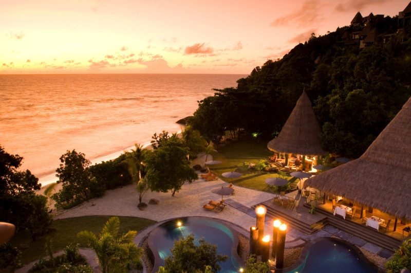 Seychelles - Mahe Island- 1554 - Maia Luxury Resort & Spa - Aerial Pool & Restaurant at sunset