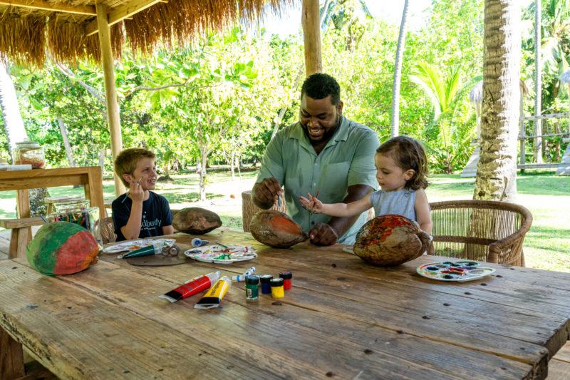 Seychelles - North Island - 1554 - North Island Resort - Coconut painting fun with staff