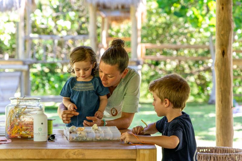 Seychelles - North Island - 1554 - North Island Resort - Kids Club - Jewellery making with staff