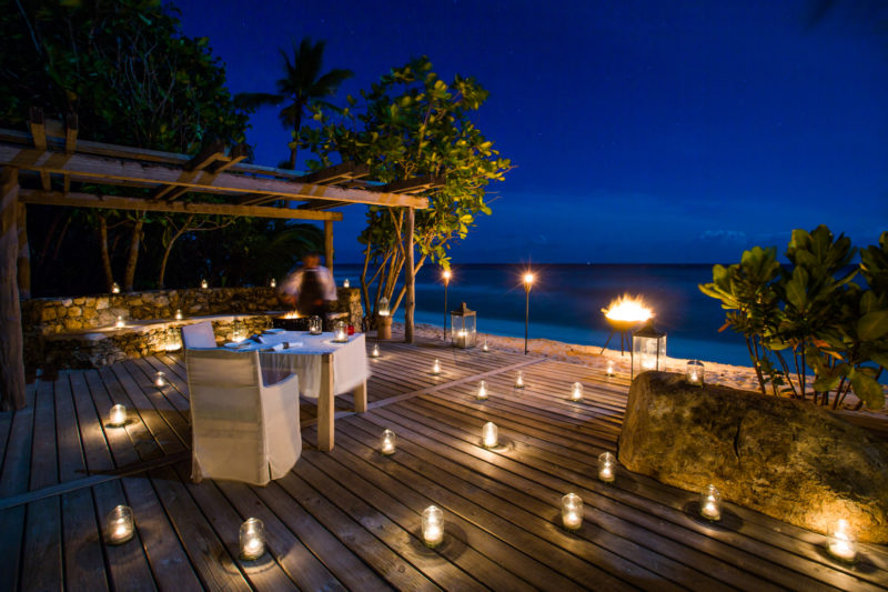 Seychelles - North Island - 1554 - North Island Resort - Romantic Private Dining - Candle light on decking