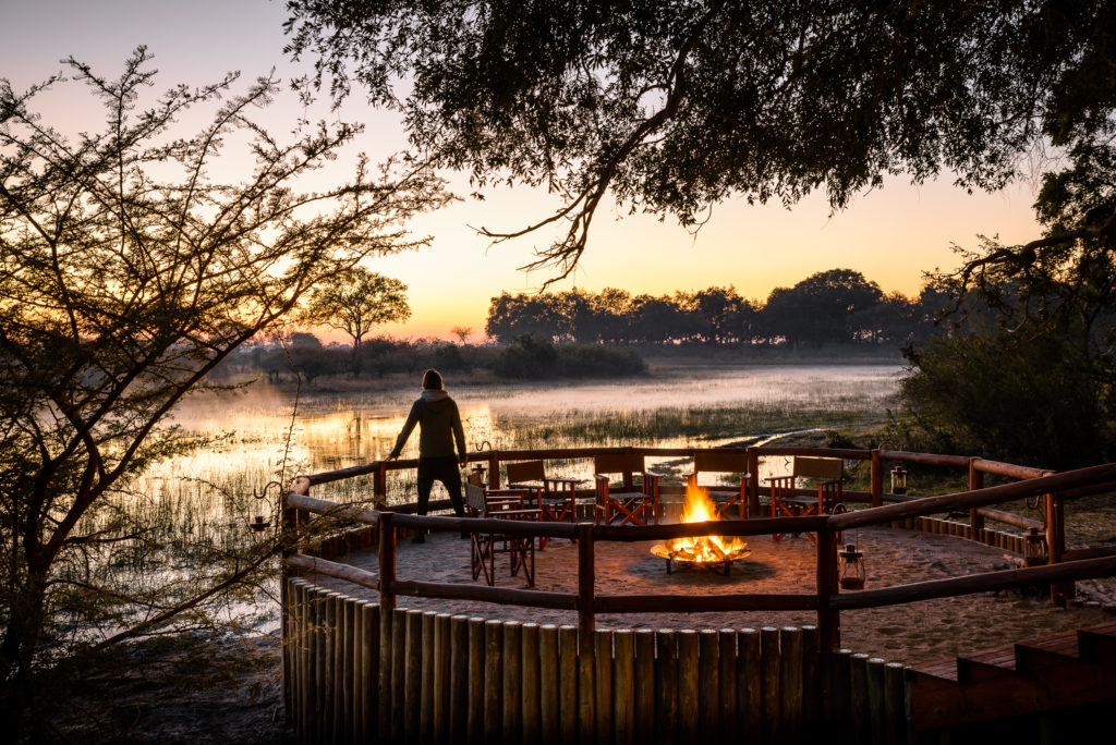 Botswana - Moremi Game Reserve - 1553 - Sanctuary Chief's Camp fire on the decking