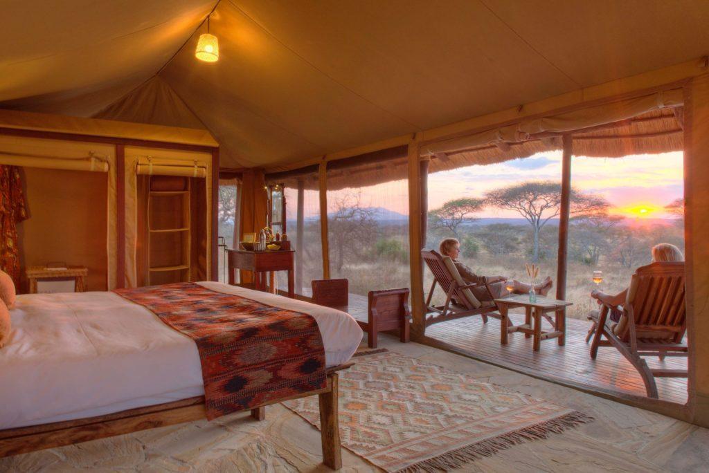 Tanzania - 17467 - Tarangire National Park - Olivers Camp - Sunset on decking with sundowner