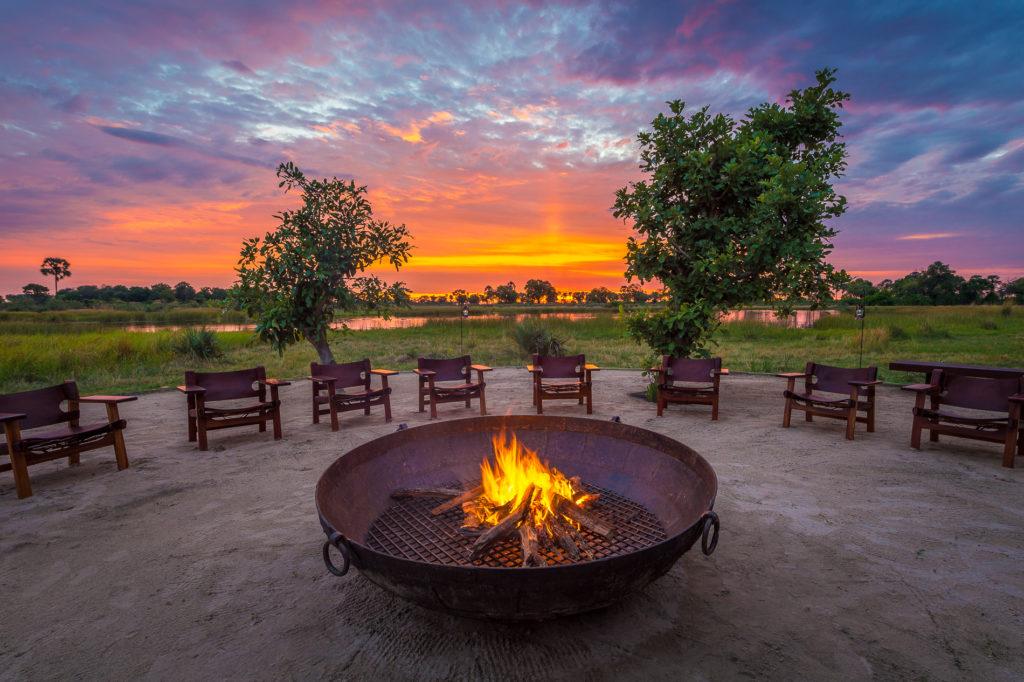 Botswana - Okavango Delta - Qorokwe Camp Boma Fire at sunset