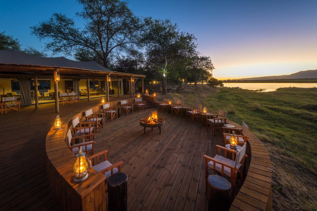 Ruckomechi Camp Mana Pools Zimbabwe Boma Fire Pit at Sunset