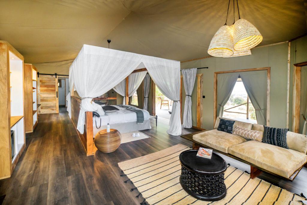 Tanzania - 17467 - Tarangire National Park - Lemala Mpingo Ridge - Tented Luxury Room - Four poster bed and seating area