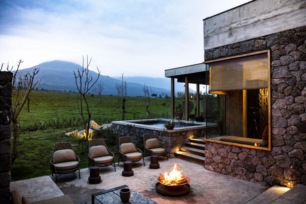 Rwanda - Volcanoes National Park - 1568 - Singita Kataza House Seating by Fire