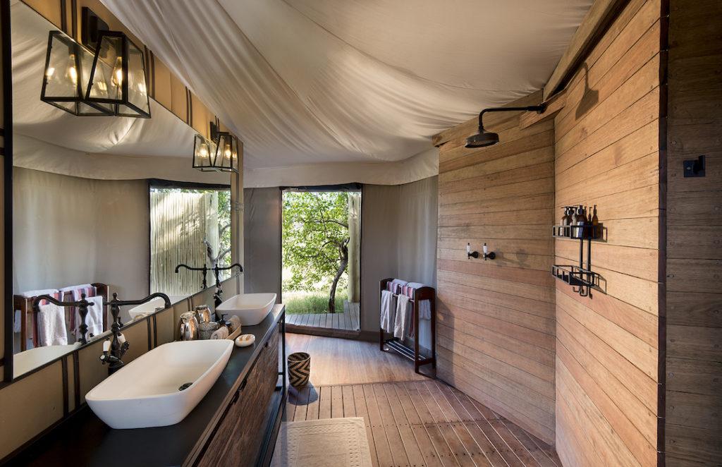 andBeyond Nxabega Okavango Tented Camp - Bathroom
